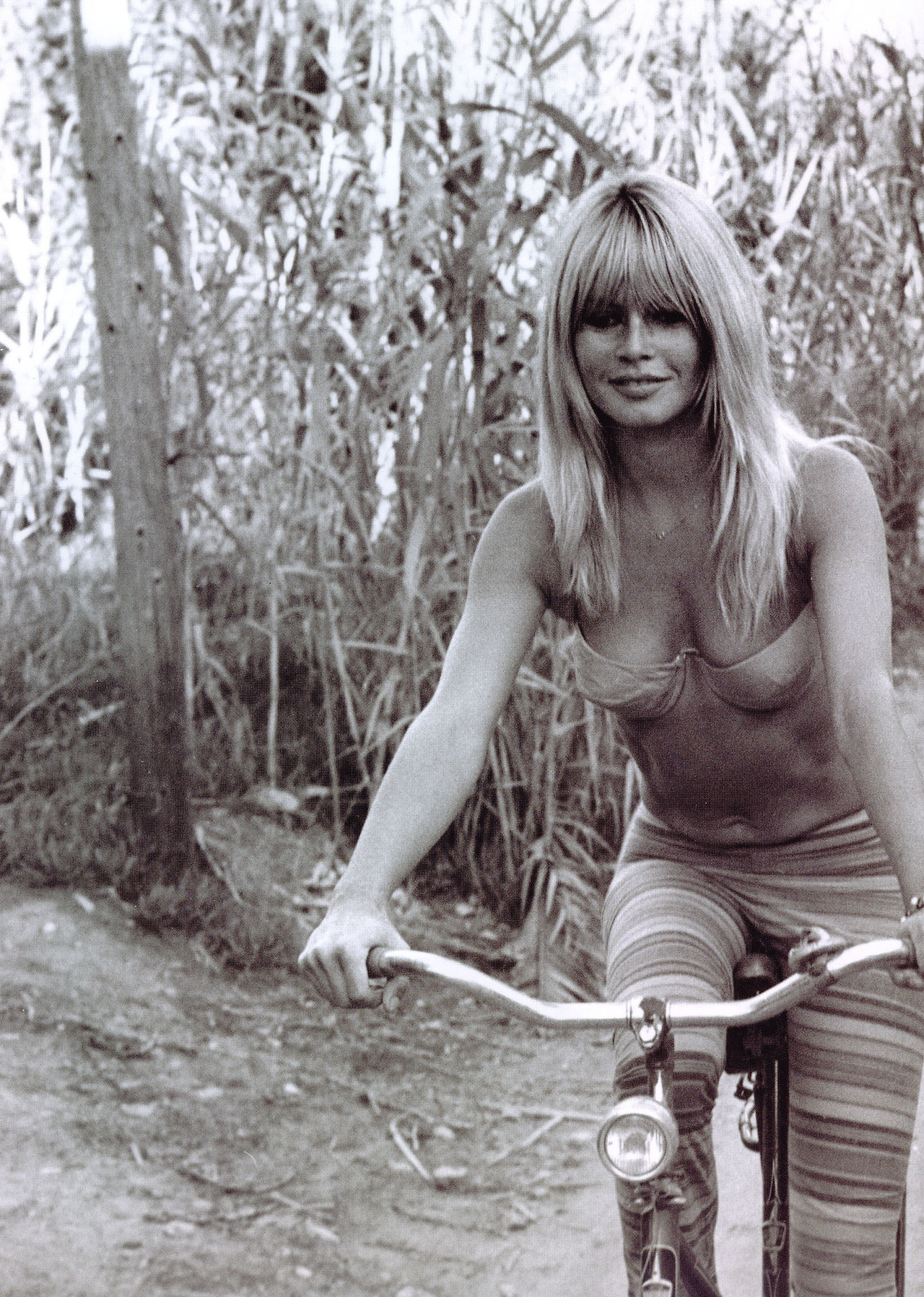 Retro downblouse Brigitte Bardot rides a bicycle in her underwear