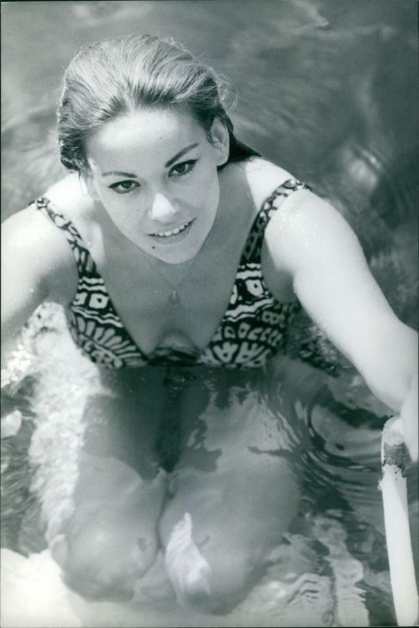 Claudine Auger in a pool.- Sep 1966