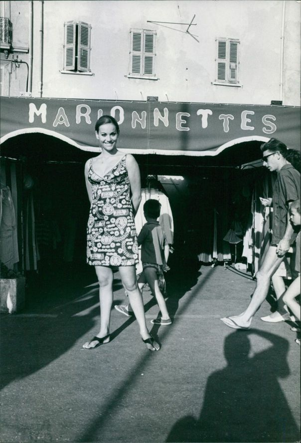 Claudine Auger smiles as she posed for the camera in a street