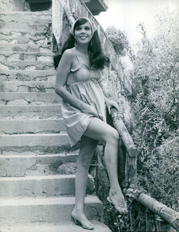 Viviane Ventura standing on staircase. -